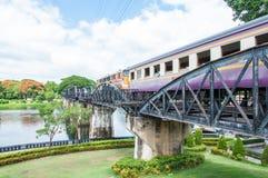 Train on the bridge over river Kwai in Kanchanaburi province, Thailand.The bridge is famous. Kanchanaburi, Thailand - May 23, 2014: Train on the bridge over Stock Image