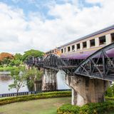 Train on the bridge over river Kwai in Kanchanaburi province, Thailand.The bridge is famous Stock Photos