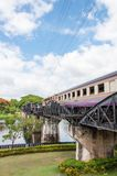 Train on the bridge over river Kwai in Kanchanaburi province, Thailand.The bridge is famous Stock Photo