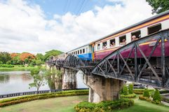 Train on the bridge over river Kwai in Kanchanaburi province, Thailand.The bridge is famous Royalty Free Stock Photo