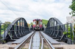 Train on the bridge over river Kwai in Kanchanaburi province, Thailand.The bridge is famous Stock Photography