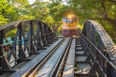 Train on the bridge over the river Kwai. Kanchanaburi, Thailand - January 5, 2015: Train on the bridge over the river Kwai in Kanchanaburi, Thailand Stock Image