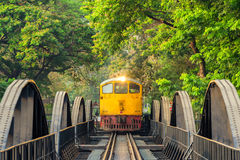 Train on the bridge over the river Kwai  in Kanchanaburi, Thailand. KANCHANABURI, THAILAND - March 27, 2016: Train on the bridge over the river Kwai  in Royalty Free Stock Photos