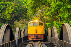 Train on the bridge over the river Kwai  in Kanchanaburi. KANCHANABURI, THAILAND - March 27, 2016: Train on the bridge over the river Kwai  in Kanchanaburi Royalty Free Stock Image