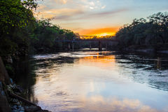 Train bridge over the Suwanee River at sunset. Royalty Free Stock Photo