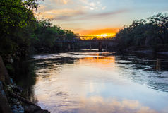 Train bridge over the Suwanee River at sunset. Royalty Free Stock Image