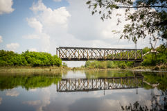 Train bridge reflected in the river. Photo of train bridge reflected in the river Stock Photography