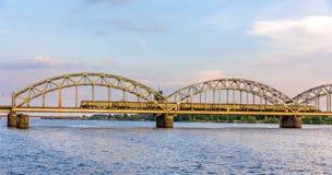 Train on a bridge in Riga Stock Photo
