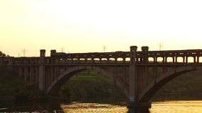 Train bridge river. The train goes through the bridge over the river stock video footage