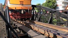 Train on the Bridge River Kwai in Kanchanaburi, Thailand stock video