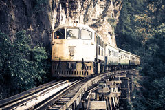 Train on The Bridge of the River Kwai in Thailand Royalty Free Stock Image