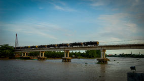 Train on Bridge. The train runs on a bridge in Thailand Stock Image