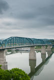 Train Bridge Spans Across the Tennessee River. A blue metal rail bridge spans across the Tennessee River near Chattanooga, Tennessee Stock Photography