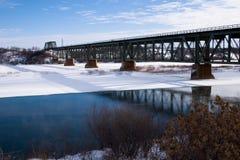 Train Bridge in Winter. The train bridge over the South Saskatchewan River in Saskatoon, Canada royalty free stock photography