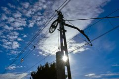 Train cables counterweight under blue sky stock photo