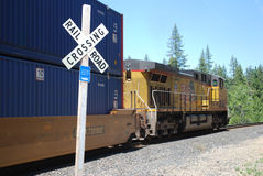 Train and caboose and railroad crossing Stock Images