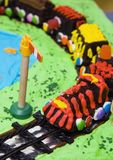 Train cake. Chocolate cake at kids party in the shape of a train stock image