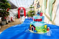 Barn Theme 2nd Birthday With Train Cake Stock Photo