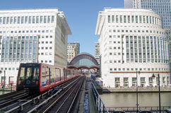 Train at Canary Wharf Station, Docklands. LONDON, ENGLAND - APRIL 2: A Docklands Light Railway train entering the station at Canary Wharf, London on April 2 2013 Royalty Free Stock Photos