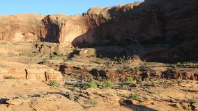 Train in canyon. Train rolling through canyon in Utah stock footage