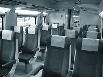 Train car. Inside of modern train monochorme image royalty free stock photo