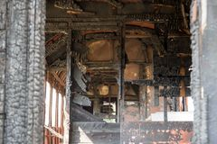 The train car burnt from the inside. The old retro vintage train car burnt from the inside Stock Images
