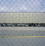 Train car through a chain link fence Stock Image