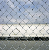 Train car through a chain link fence Royalty Free Stock Images