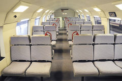 Train car interior. Seats row inside modern train car Royalty Free Stock Photography