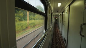 In the train car, a long corridor with a door in the compartment. Static shot. In the train car, a long corridor with a door in the compartment stock video footage