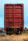 Train Car from Rear. A train car rests in the trainyard on the praries of Alberta Royalty Free Stock Image