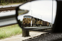 Train in Car Side Mirror Royalty Free Stock Images