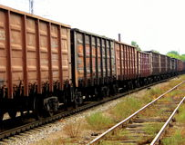 Train with cargo containers. Old cargo containers connected together to form train royalty free stock photo