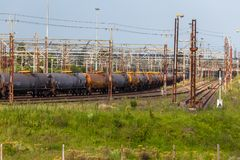 Train Cargo Tankers Station. Train with cargo pulls into station transporting jet fuel tankers Stock Image