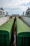 Train on the cargo vessel. Train loaded on the cargo vessel on the sea Stock Image