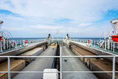 Train on the cargo vessel. Train loaded on the cargo vessel on the sea Stock Photos