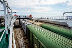 Train on the cargo vessel. Train loaded on the cargo vessel on the sea Royalty Free Stock Photo