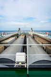 Train on the cargo vessel. Train loaded on the cargo vessel on the sea Stock Photo