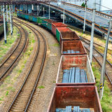Train with cargo wagons. On the railroad Stock Photos