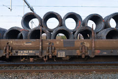 Train cargo wagons. Row of train cargo wagons with rolls of steel wire Stock Photos