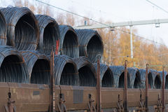 Train cargo wagons. Row of train cargo wagons with rolls of steel wire Stock Image