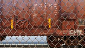 Train Carriages Passing Behind Chain Link Fence stock video footage