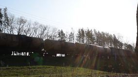 A train transporting goods. Train carrying goods, train wagons of a going train stock video