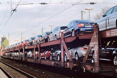 The train with cars - Automobile. Proceeding from south to the north of Germany stock photo