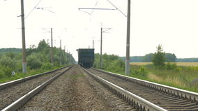 Train cars leave far away stock video