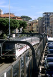 Train and cars in Rome Stock Image