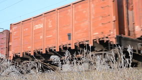 Train cars to go the rails. Freight train traveling on railway close-up on a sunny day stock footage