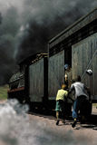 Train catching. Exterior day, under a big storm Stock Image