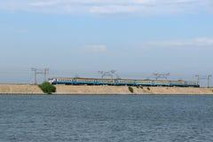 Train on causeway line at Kakhovka Water Reservoir, Ukraine.  stock image
