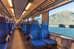 Train chairs and mountain view through the window Royalty Free Stock Photos
